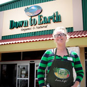 Photo: Down to Earth Manager in Front of Kahalui Store